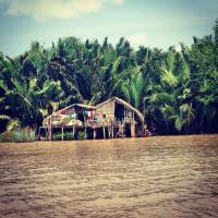 This photo was taken during an excursion to the Mekong Delta during my study abroad program. Many communities live and rely on the Mekong Delta--as you can see here, this house is built literally into the river and is held up by wooden stilts. With shifting weather patterns and a lack of understanding about waste management, the region is starting to experience intense flooding, polluted waters, and an increase in disease and overall hygiene. This area of Vietnam is particularly rural and very few people have access to and can afford proper healthcare. The Mekong Delta runs through five different countries (China, Myanmar, Laos, Thailand, and Cambodia) before finally reaching Vietnam, which makes this issue a more complicated, international problem rather than an easy in-country fix. [Mekong Delta, Vietnam] (Credit: Willa Sweeney)